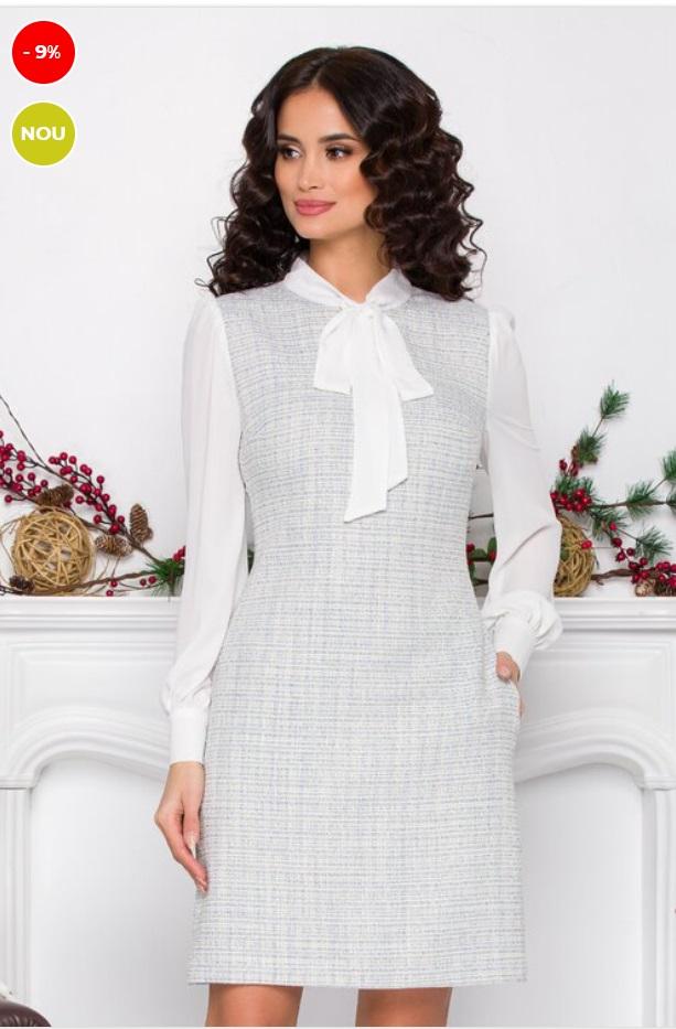 Rochie office din tricot, combinat cu voal. Are un croi usor cambrat, guler la baza gatului cu funda, maneci lungi din voal cu mansete